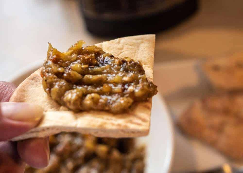 roasted eggplant dip on pita bread close up