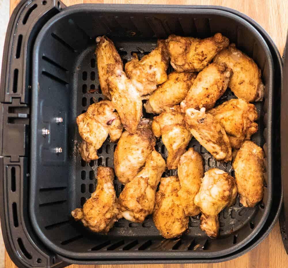 crispy done jerk wings in the air fryer basket