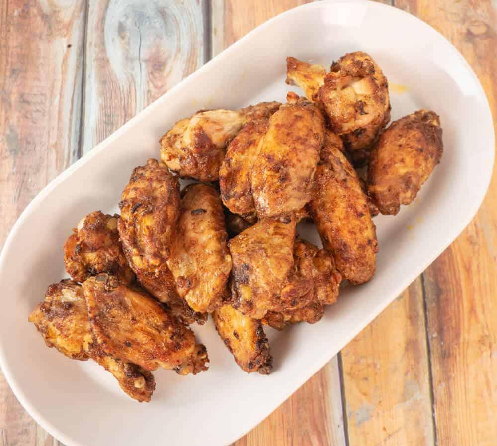 Overhead view of crispy and spicy golden brown jerk wings