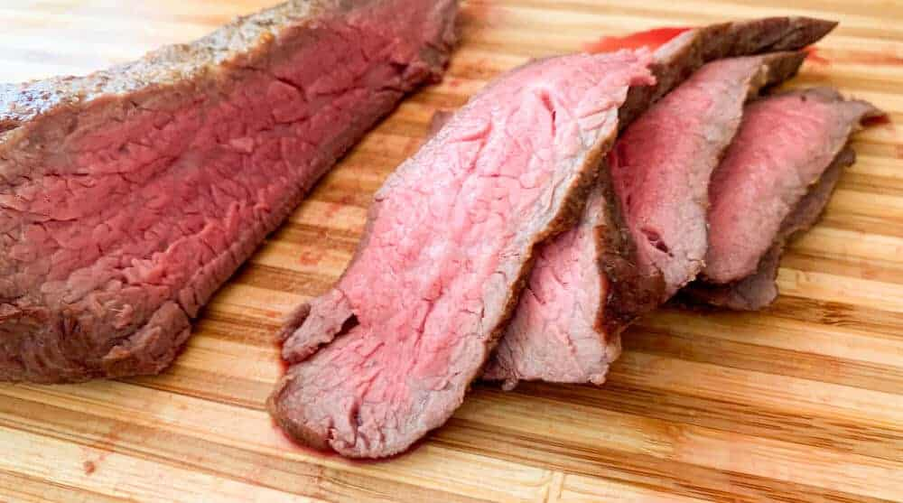 Beautiful rare sliced beef tri tip roasted in the oven.