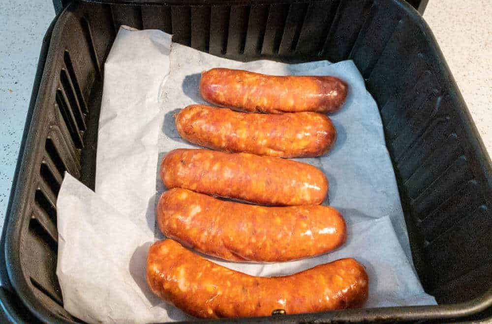 Italian sausage in the air fryer on parchment paper