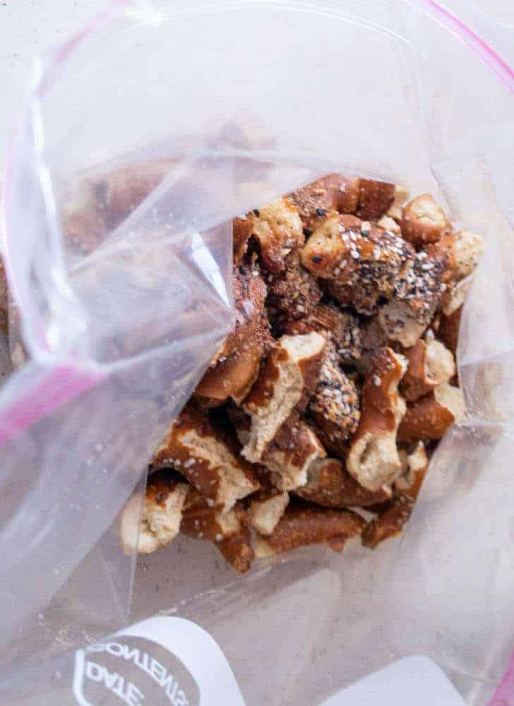 placing pretzels in zip back with spices and oil to coat before cooking