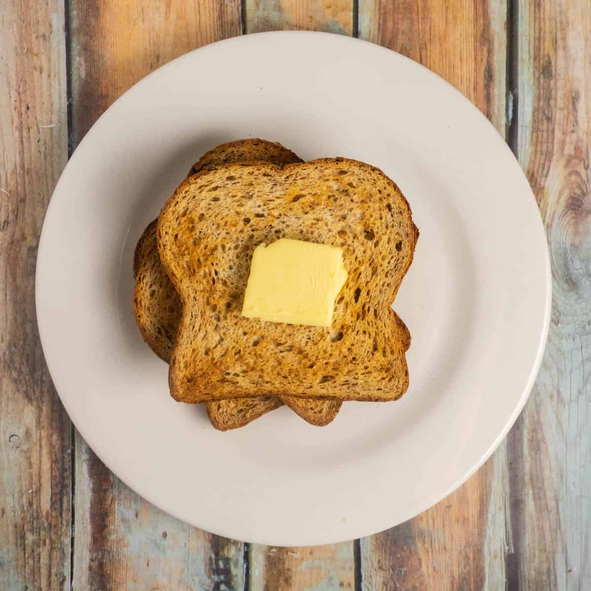 toasted bread above view toasted and golden brown with butter.